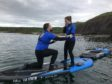 Ruari Dickie pops the question to Sarah Steel while paddleboarding