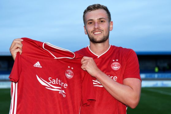 James Wilson after signing a permanent deal with Aberdeen