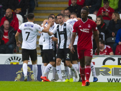 St Mirren come together as a team to celebrate an early goal by Ilkay Durmus