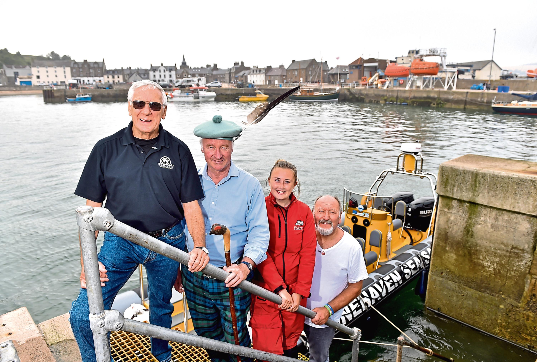 Mayor Ronnie Marks, clan chief Richard Holman-Baird, Rosie Martin of Stonehaven Sea Safari and Phil Mills-Bishop