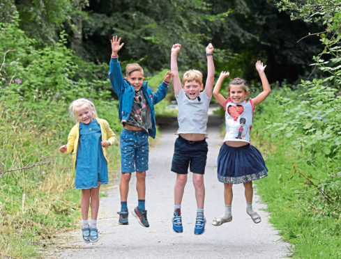 From left, Iona Hamilton, Daniel Fox, Dylan Hamilton and Sasha Fox, who set up a cake and lemonade stand on the old Deeside railway line