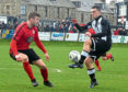 Fraserburgh's Scott Barbour is watched by Loco's Mark Souter