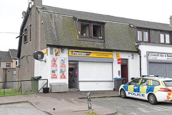 Police at the scene following the fire at a property above Premier Express on Lintmill Terrace in Northfield.