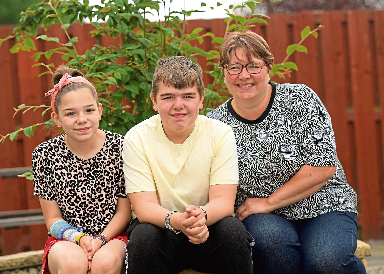 Joshua with his sister Lauren Bramman and mum Kay Mutch.
