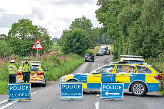 Police at the scene of the two-vehicle collision on the B9170 between Oldmeldrum and Methlick on Saturday