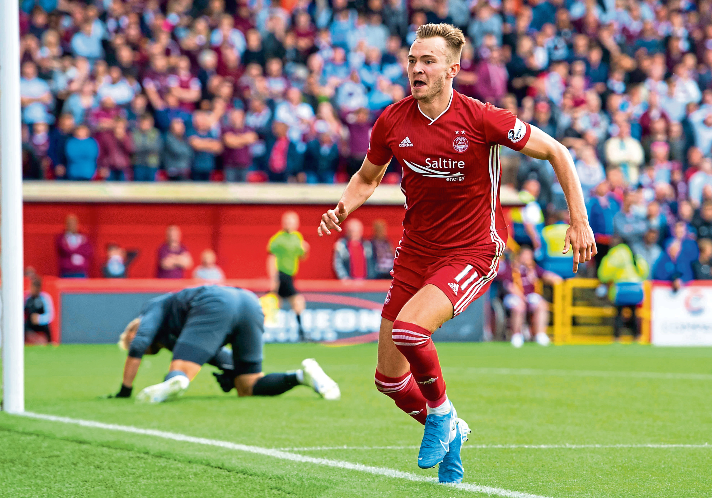 Ryan Hedges celebrates after making it 3-2 to Aberdeen against Hearts on the opening day of last season.