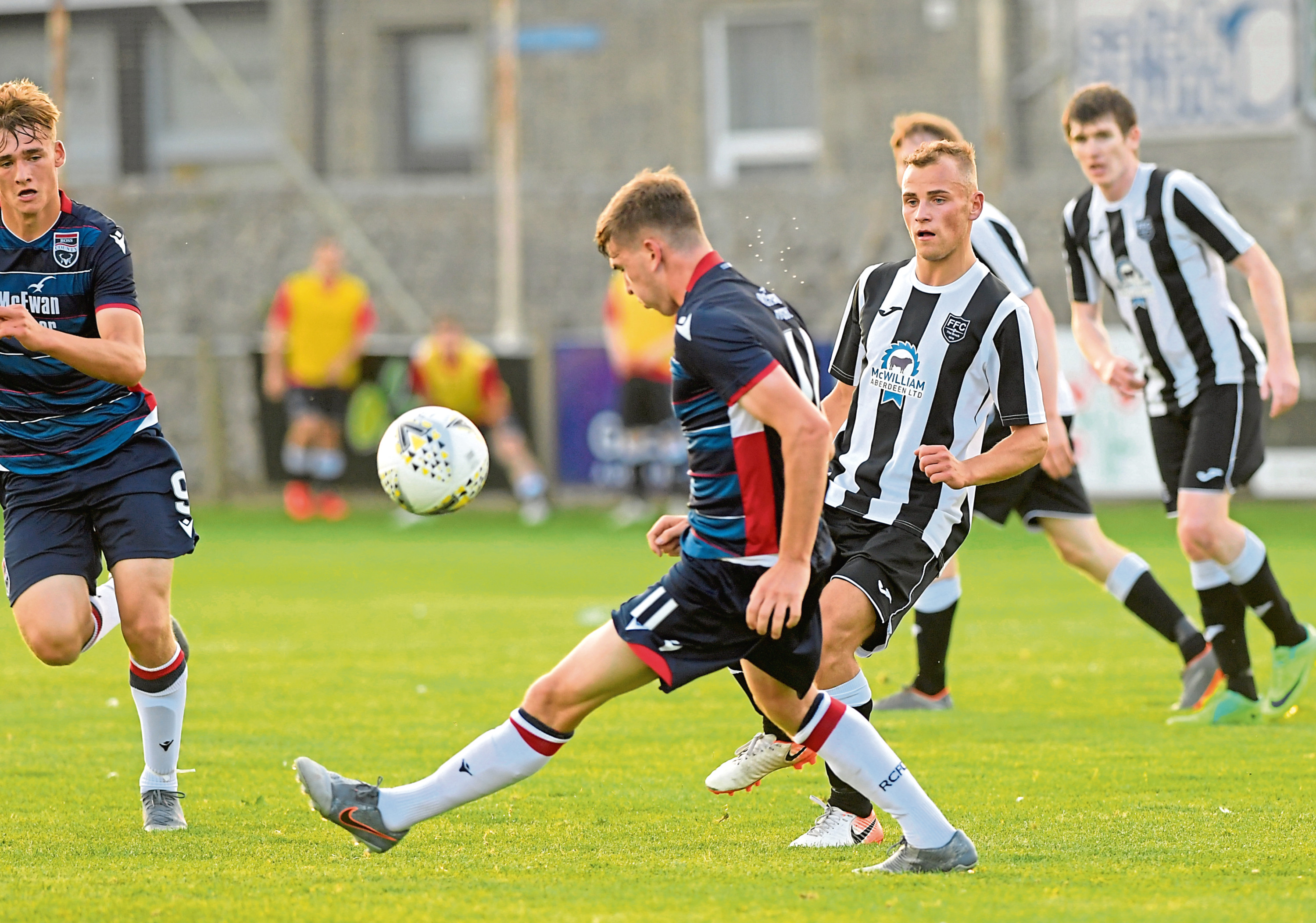 Fraserburgh's Greg Buchan and Ross County's Declan Hughes.