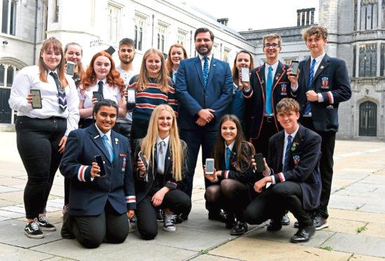 Aberdeen City Council education convener John Wheeler with students from Aberdeen Grammar, Harlaw Academy and St Machar Academy