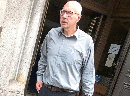William Cressy leaving Aberdeen Sheriff Court