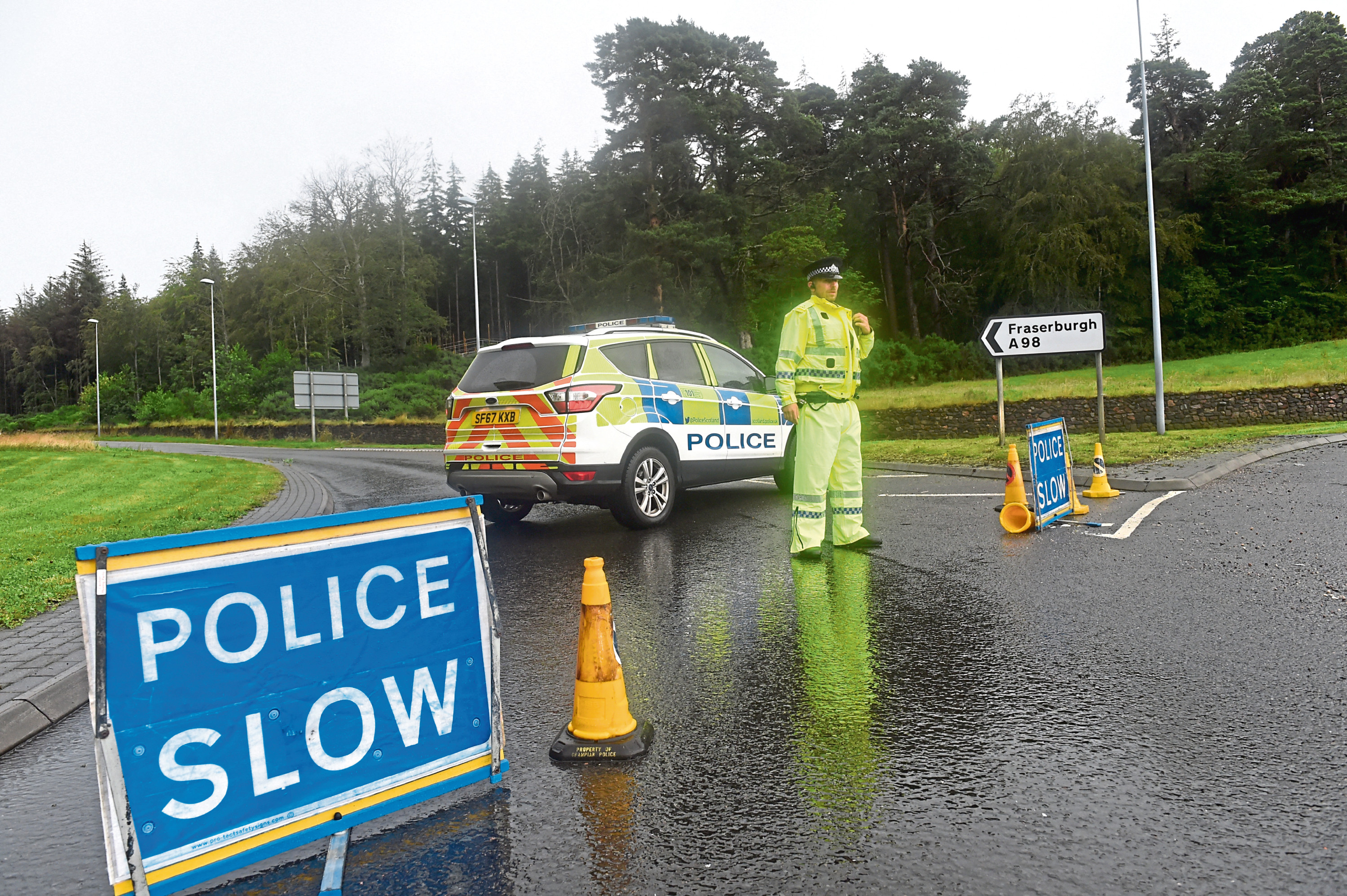 Police at the scene of the accident on the A98