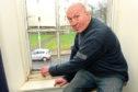 reddie Cumming, 63, wants Aberdeen City Council to repair his windows.