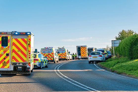 Emergency services at the scene on the A98 last year