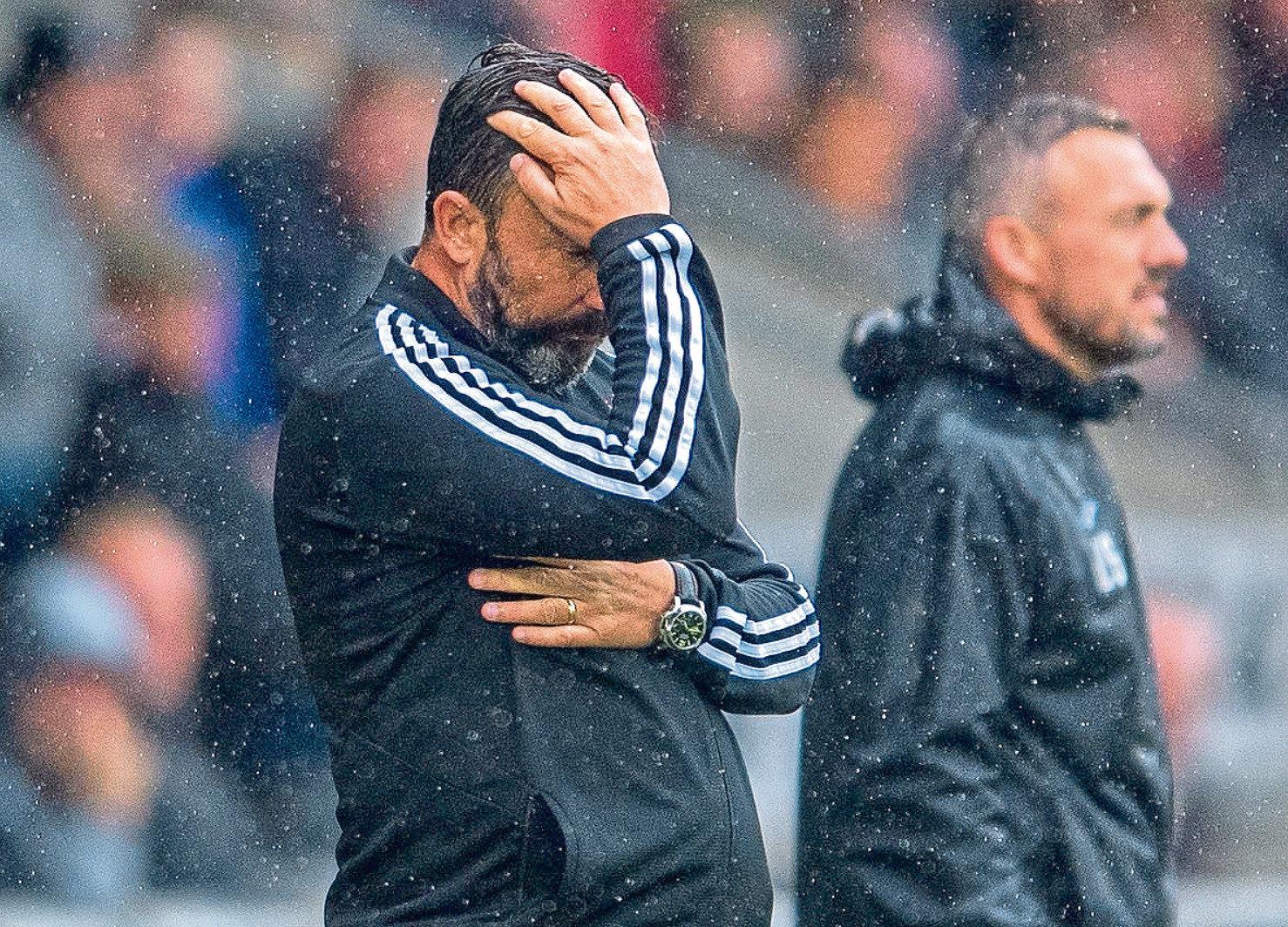 Aberdeen manager Derek McInnes looks dejected
