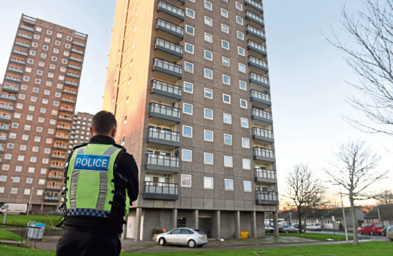 Police attend the incident at Donside Court where Aleksander Smerdel was found dead