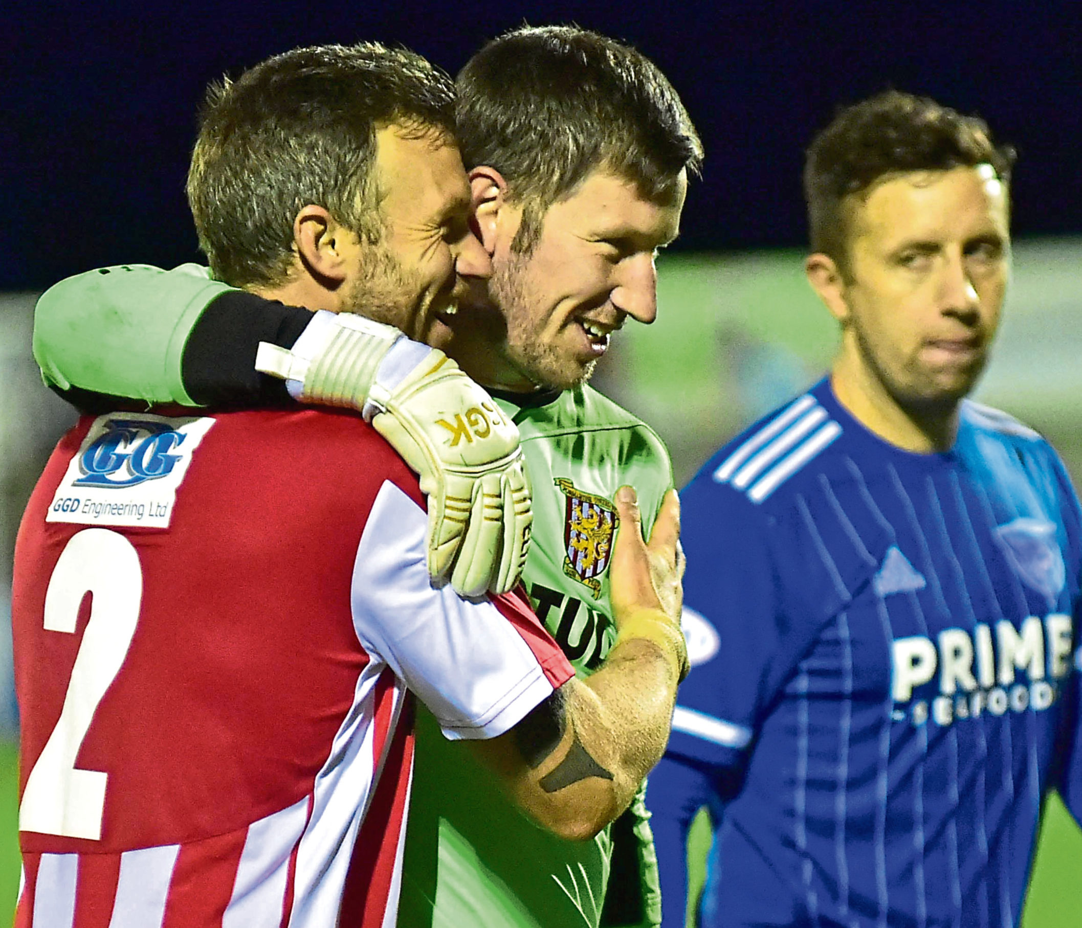 Formartine hero Kevin Main celebrates with Wayne Mackintosh