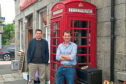 Councillor Robbie Withey and West Aberdeenshire and Kincardine MP Andrew Bowie at the Monymusk Phone Box