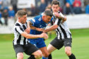 Willie West (right) in action for Fraserburgh against Peterhead