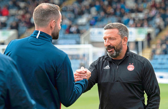 Aberdeen manager Derek McInnes, right, shakes hands with Dundee manager James McPake.