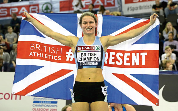 Zoey Clark celebrates winning the Women's 400 metres final during day two of the SPAR British Athletic Indoor Championships at Arena Birmingham.
