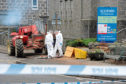 Police at the scene of the botched ATM theft in Torphins – one of the raiders is appealing to have his sentence cut
