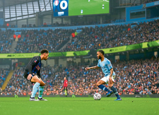 Zak Vyner of Rotherham United and Raheem Sterling of Manchester City during the FA Cup Third Round match between Manchester City and Rotherham United at Etihad Stadium on January 6, 2019