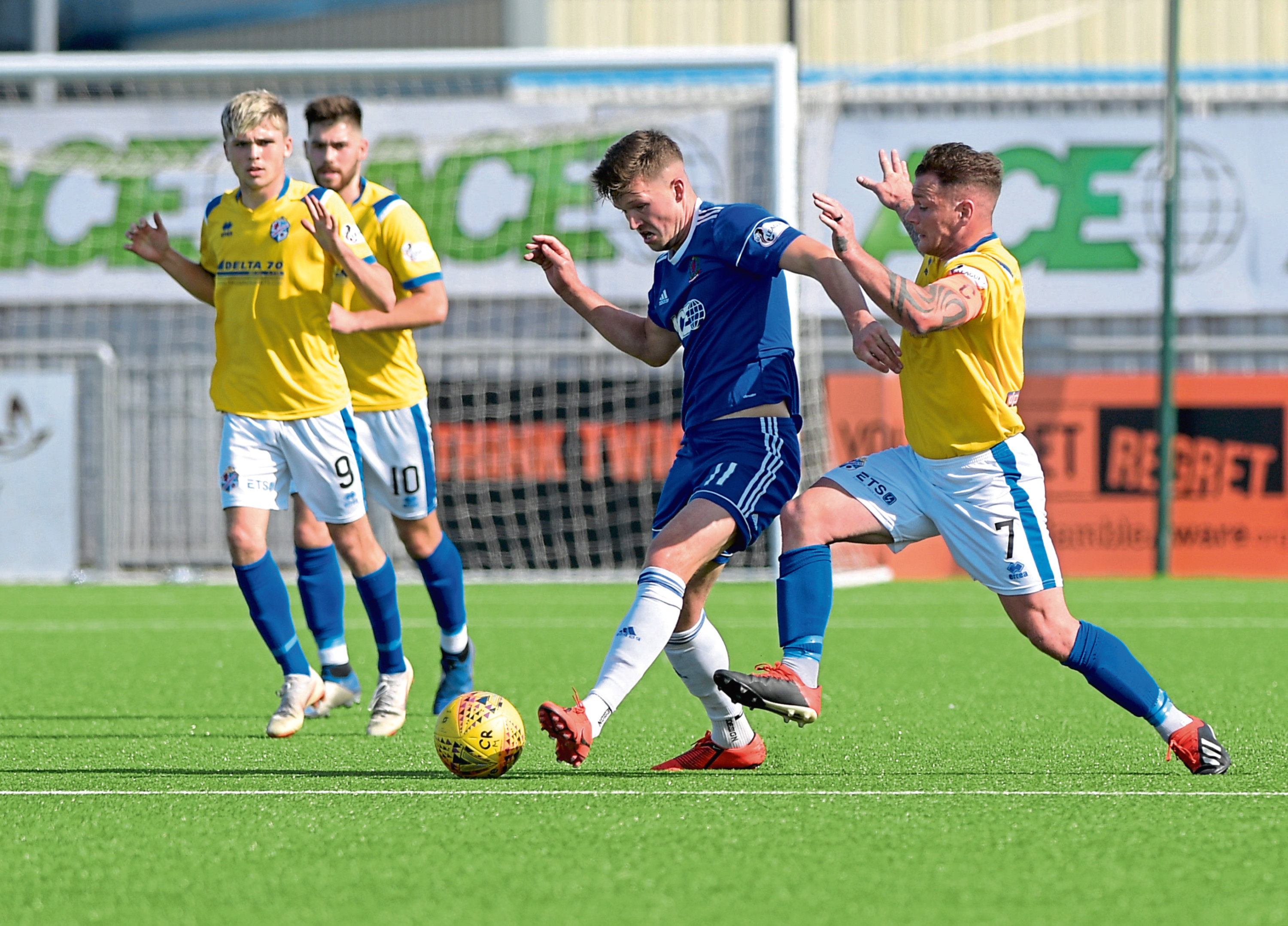 Cove's Jamie Masson and Cowdenbeath's David Cox. Picture by Kath Flannery