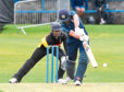 Scotland's Calum MacLeod and Papua New Guinea wicketkeeper Kiplin Doriga. Picture by Chris Sumner