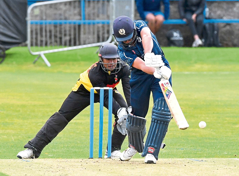 Scotland's Calum MacLeod and Papua New Guinea wicketkeeper Kiplin Doriga. Picture by Chris Sumner