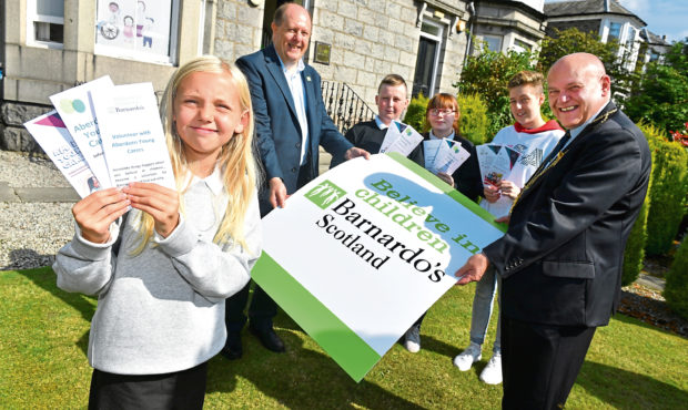 Young carers, Alesha Ross, 10, Stephen Forbes 14, Marley Mearns 14, Kaidon Stevens, 17 and looking on from left are, Martin Crewe Director of Barnardo's Scotland and Lord Provost Barney Crockett