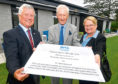 Billy Hunter, past president of the Rotary Club of Stonehaven, which helped with fundraising, Dr Neil Edward and Dr Ann Humphrey