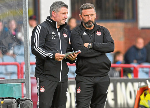Aberdeen manager Derek McInnes, right, speaks with assistant Tony Docherty.