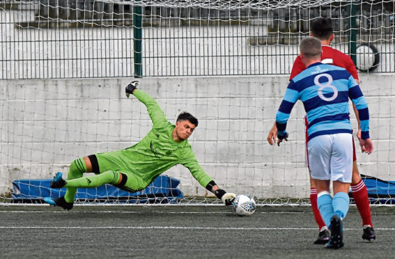 Sam Jackson saving a free-kick. Picture by Kenny Elrick