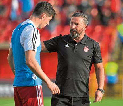 Departed Aberdeen defender Scott McKenna, left, and manager Derek McInnes.