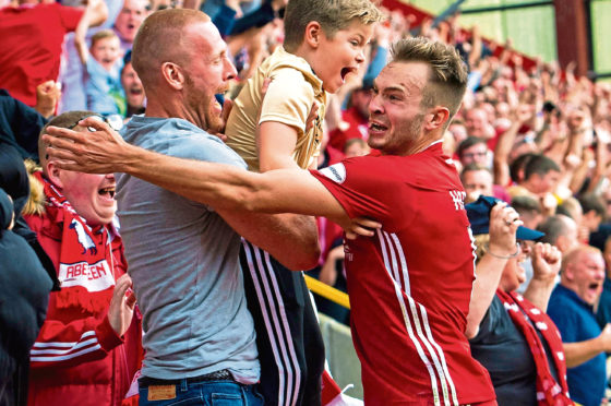Ryan Hedges celebrates with the home support after making it 3-2 to Aberdeen against Hearts.