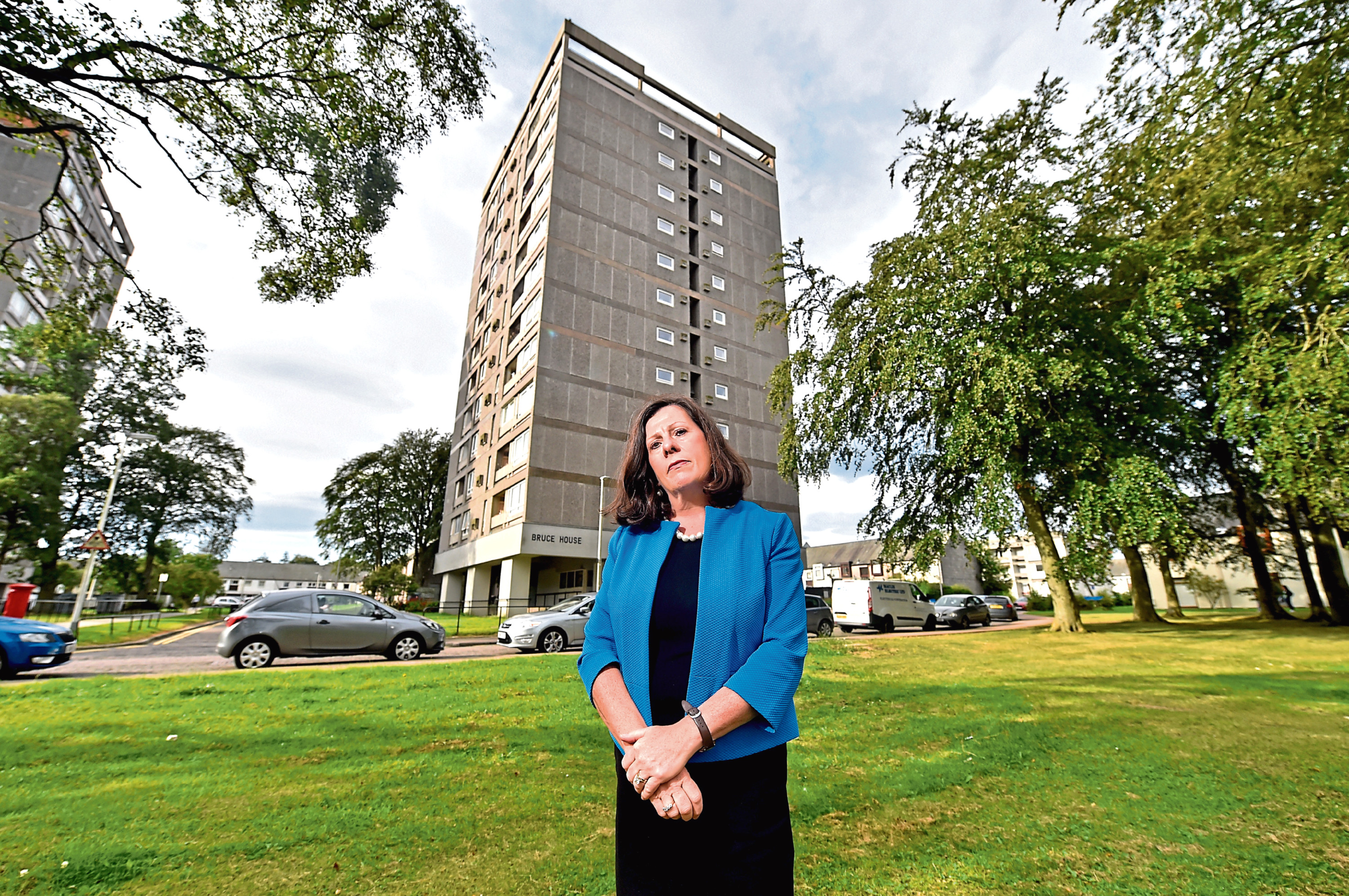 Councillor Jennifer Stewart outside Bruce House flats after several fires there