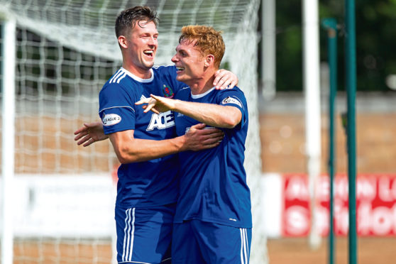 Fraser Fyvie celebrates his opening goal against Stirling with Jamie Masson.