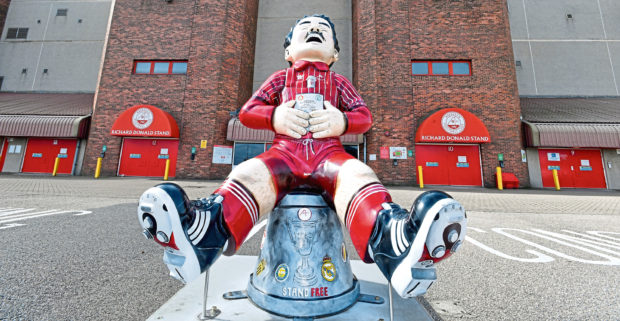 The Oor Wullie Miller statue takes pride of place outside Pittodrie ahead of Aberdeen's game today against Ross County. Photo by Chris Sumner.