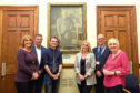 Amanda Caldwell, Colin Laird, Dallas King, Nicky Caldwell, Ewan Scott and Patricia Brown with the portrait of Marcus Kelly Milne.