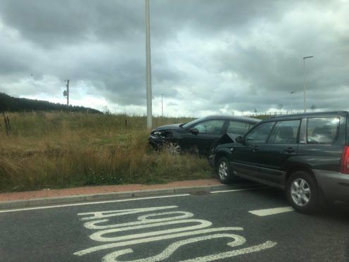 The two cars have crashed on the A944