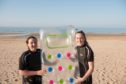 Isla and Eilidh Noble with the lilo used in the rescue