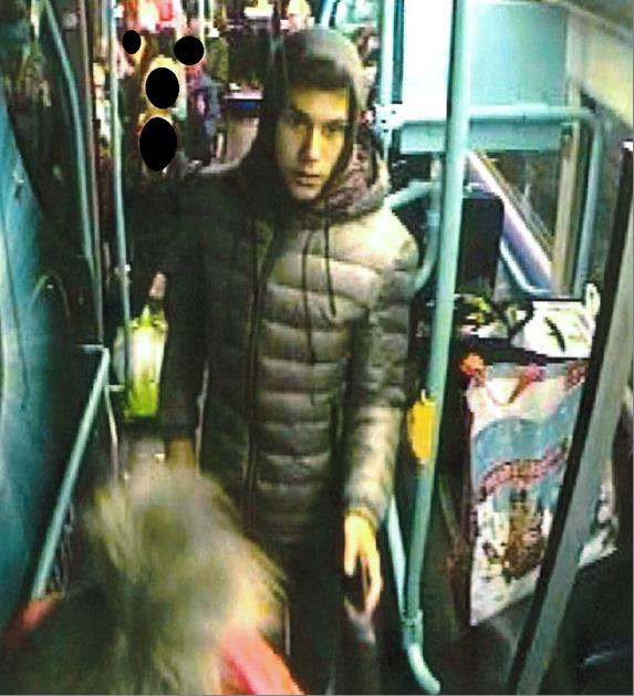 A CCTV image of a man police wish to speak to following a number of attacks on buses
