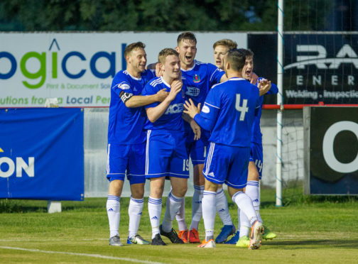 Cove's John Robertson celebrates as he seals the 2-1 victory over Brora