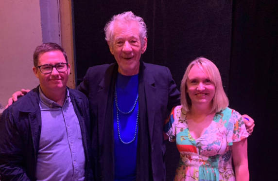 Sir Ian McKellen with staff at the theatre