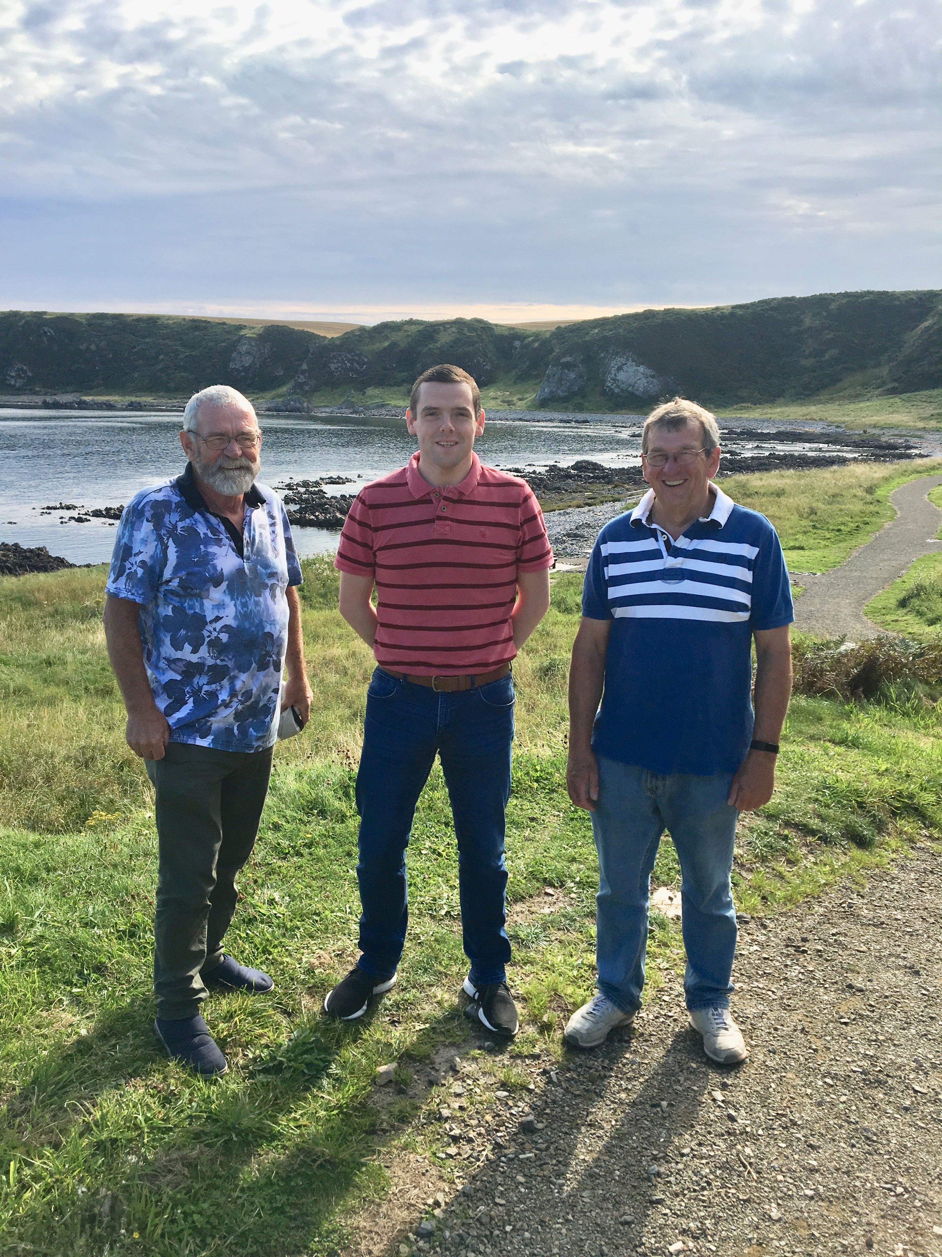 Douglas Ross on the coastal footpath in Cullen with volunteers Stan Slater (right) and Alex Donn.