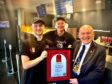 The award being presented to staff at Low's Traditional Fish & Chips by Lord Provost Barney Crockett
