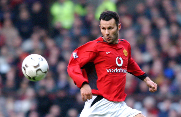 Giggs in action for Manchester United in 2002