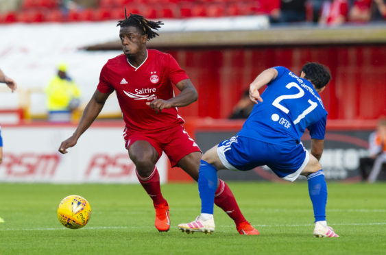 Greg Leigh in Europa League qualifying action for the Dons.