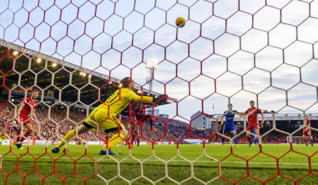 Greg Leigh scores to make it 3-0 at Pittodrie against Chikhura in the Europa League last season.