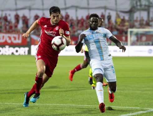 Aberdeen's Scott McKenna, left, competes with Maxwell Acosty