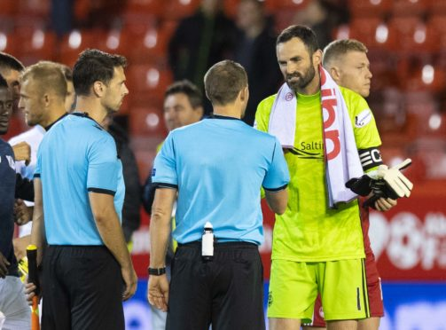 Aberdeen captain Joe Lewis, right, speaks with the referee at full-time